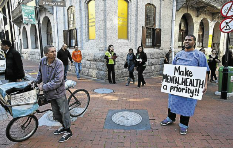 A member of Cape Mental Health and the Cape Consumer Advocacy Body protests in St Georges Mall, Cape Town, against the lack of adequate resources. Photo: Halden Krog